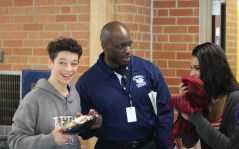 Ssebugawo can be seen joking with students. He makes it his goal to make students feel comfortable and welcome at Loy Norrix. Photo Credit / Rachel Zook