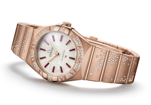 Reloj OMEGA dorado con diamantes