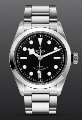Reloj Tudor plateado con detalles en color negro y blanco