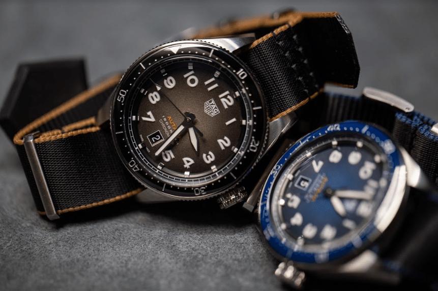 Relojes en color negro con anaranjado y negro con azul ambos con detalles en blanco