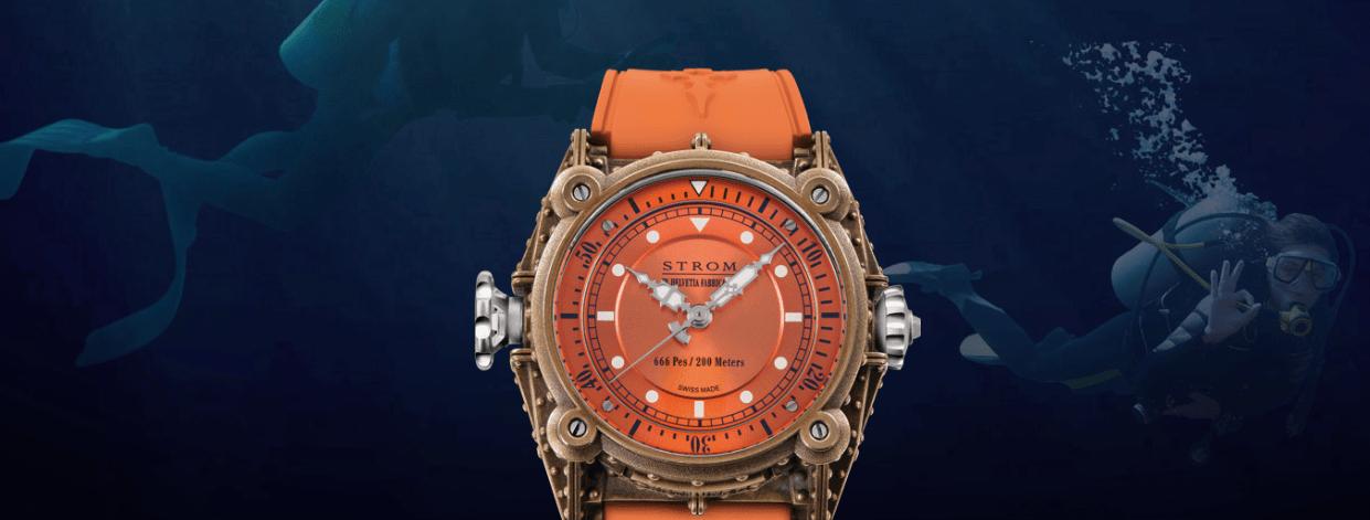 Reloj con correas en color naranja con detalles en color dorado con plata y blanco