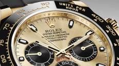 Reloj rolex uno de los relojes mejor valuados con detalles dorados y negros con taquímetro