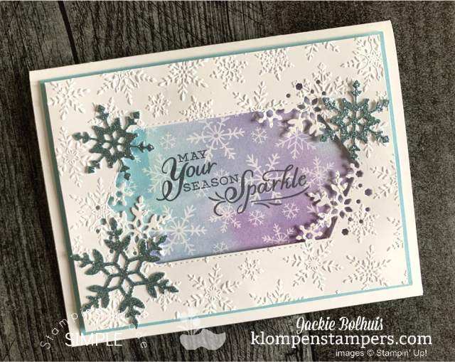 snowflakes-die-cut-from-blue-glitter-paper-for-card-embellishment