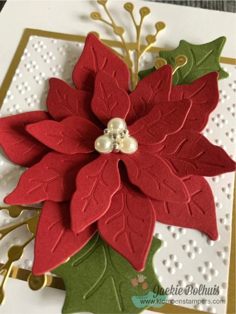 Here is a close up of pearl embellishment on top of this elegant red poinsettia