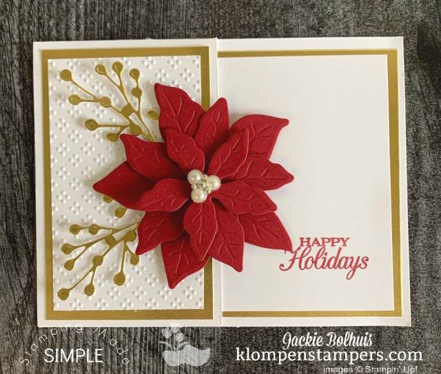 This elegant Christmas card has a side fold with a red Poinsettia on top