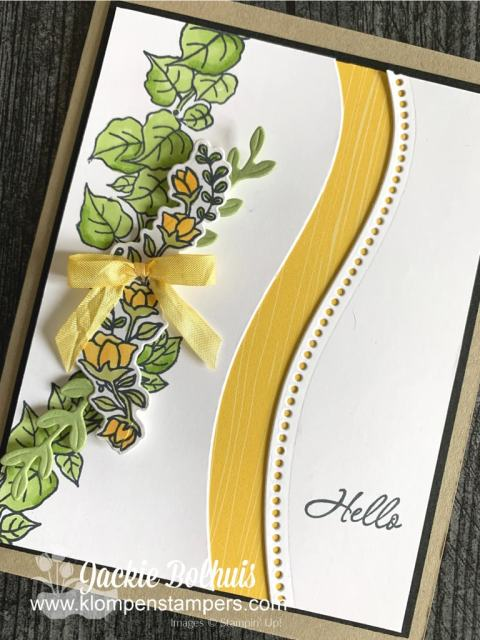 This quite curvy card features a row of hand stamped flowers colored in yellow with alcohol markers.