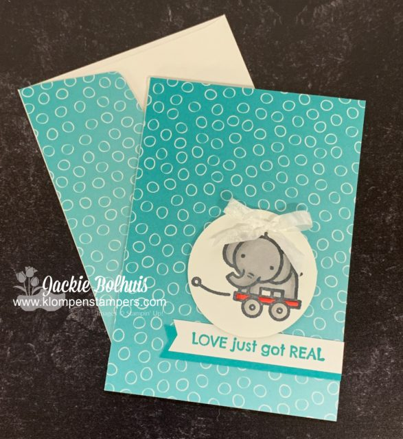 This adorable handmade baby card features a baby elephant in a wagon and some ombre designer paper.