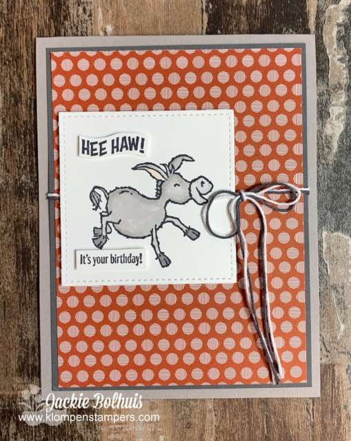 Handmade birthday card with donkey colored with stampin blends on top of a sheet of designer paper.
