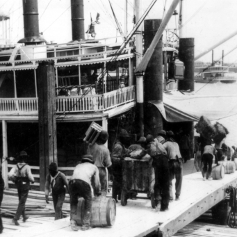 Rousties loading a riverboat