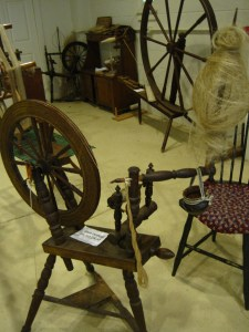 This is a spinning wheel from the Landis Valley Museum. The white stuff on the distaff are the flax fibers--what a straw stalk lacks.