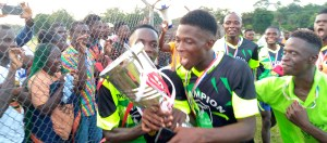 Heaven Eleven players celebrating their trophy at the EB Stadium in Yekepa, Nimba County