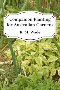 Book cover - Companion Planting for Australian Gardens by K. M. Wade - a photo of various companion plants all mixed together in one bed is overlaid with the book title and author