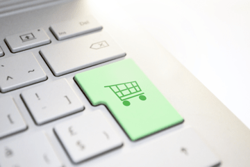 A computer enter key has been replaced with a shopping cart key — this image represents transitioning prospects from your blog posts to your sales pages