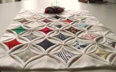 cathedral window quilt with the old pincushion made by my grandma