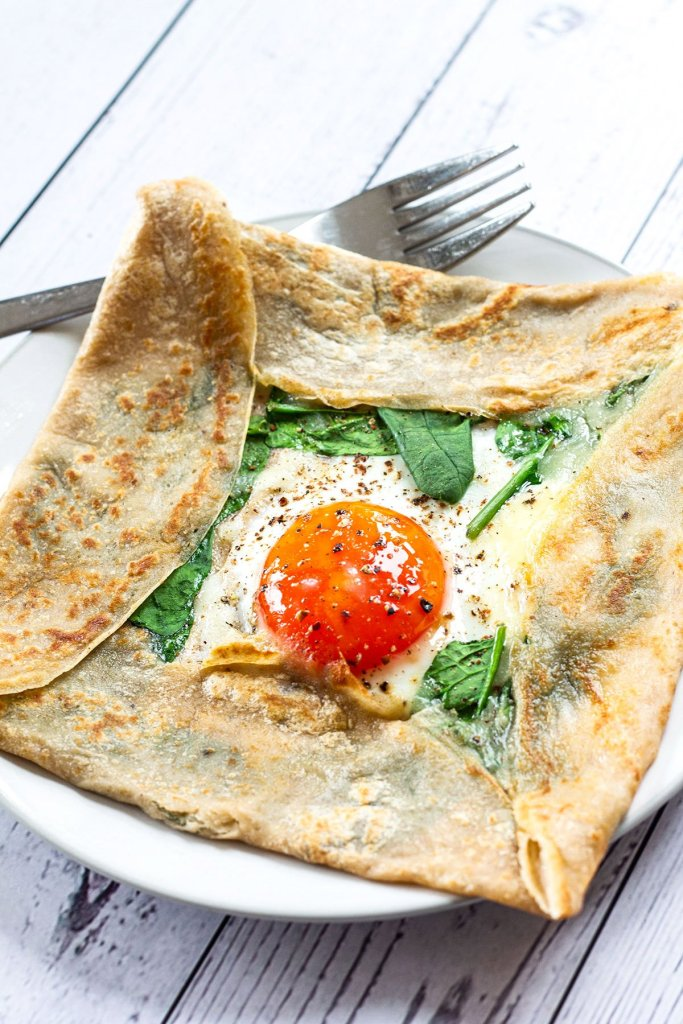 plated French buckwheat crepe with a fork