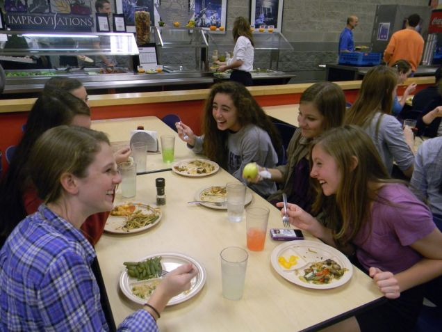 Freshmen Carolina Abdullah, Melissa Moyers, Christina Darland, and Grace Francouer laugh at a funny story while enjoying lunch.