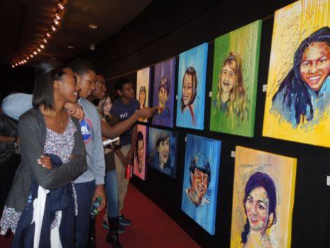 Sophomores Morgan Brewton-Johnson, Armani Lashley, Hannah Seabright, and Baiza Cherinet admiring Donice's paintings