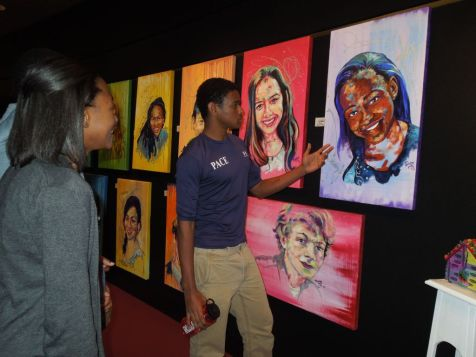 Sophomores Morgan Brewton-Johnson and Baiza Cherinet admiring a painting of Morgan