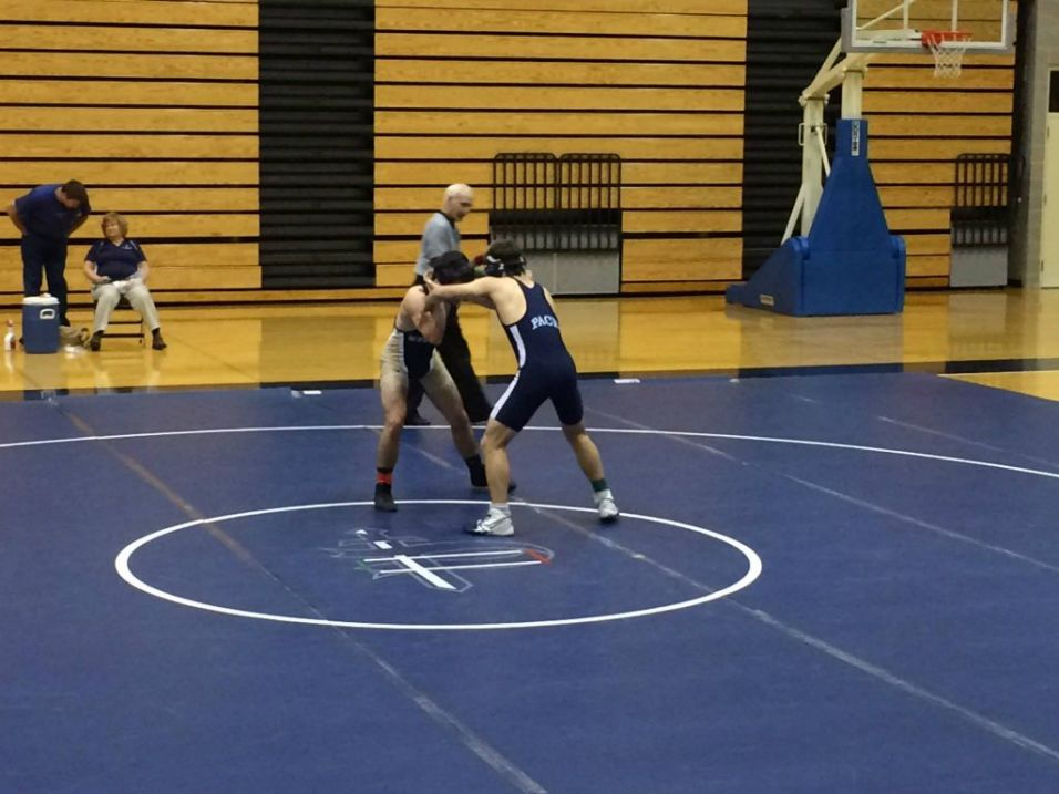 Michael Sloman (right) defeats a Mt. Vernon wrestler