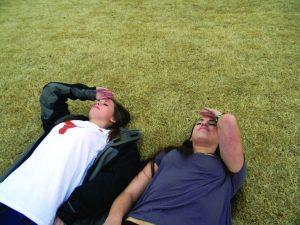Seniors Mary Liles Fiveash and Olivia Levine practice tanning on the lawn for spring break. Photo: Wylie Heiner