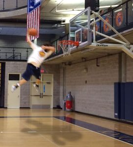 Teacher Jonathon Day shows his jumping ability on the basketball court