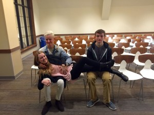 Senior Frances Crisler casually lays across two of her men: senior Mitch Inman and junior Avery Herman.