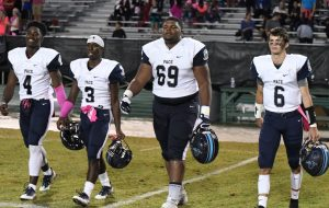(L-R) Captains Deon Jackson, Mark Sommerville, Jamaree Salyer and Gunnor Faulk take the field for the coin toss.