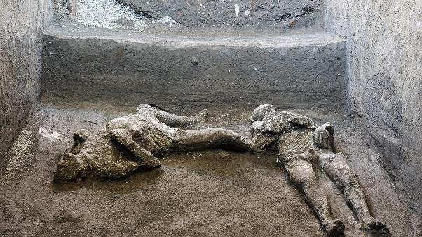 Bodies of man and slave unearthed from ashes at Pompeii