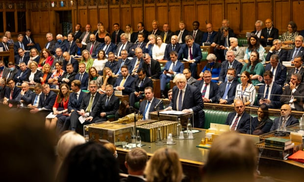 Ministers accused of putting staff at risk by not wearing masks in Commons