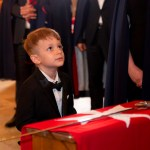 A young Squire receiving his vows before Prince Jose. One of the questions was will be obey his teachers in school. Answer: No! A rousing laugh and applaud was given for he was being truthful. But according to his parents, he is a good boy and will make a fine Knight one day. Valetta, Malta 2019