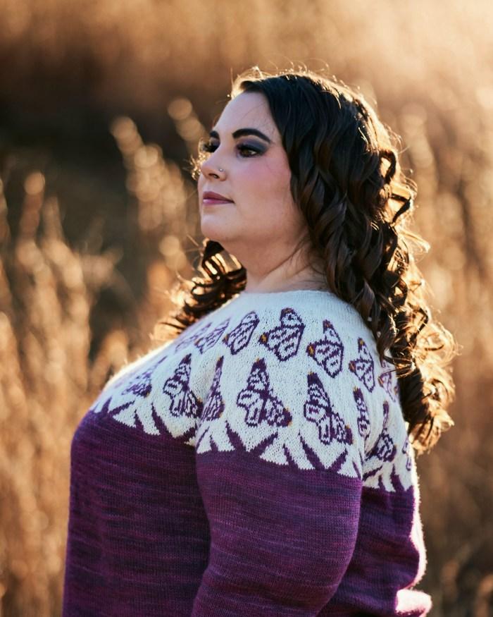 Side closeup of a purple Monarch sweater