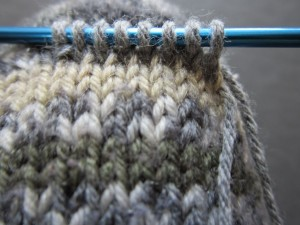 how to fix a hole in a sock with a knit on patch.