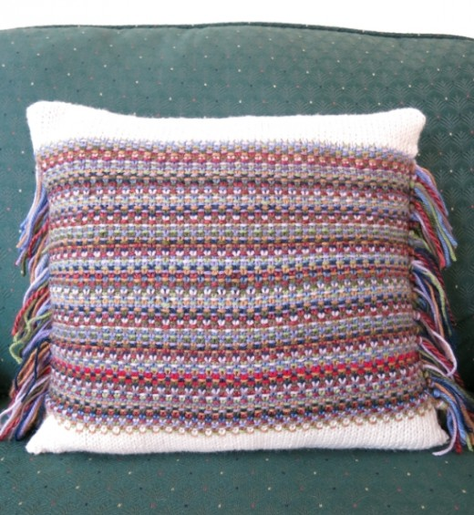 Knit a pillow with odd balls and use the ends as fringe.