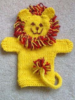 knit lion puppet