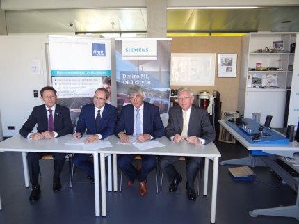 Vertragsunterzeichnung mit Siemens