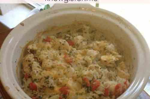 Chicken and rice bake in a casserole dish by a window.
