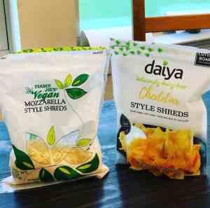 A bag of Trader Joe's Mozzarella Style Shreds and a bag of Daiya Cheddar Style Shreds