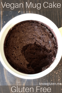 A chocolate vegan mug cake with a spoonful missing.