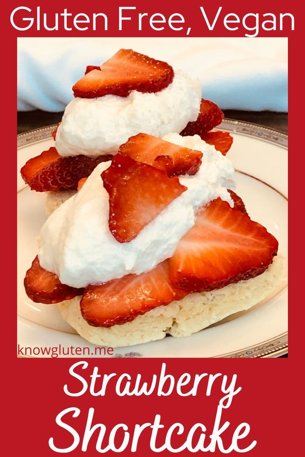 Two gluten free strawberry shortcakes on a china plate.