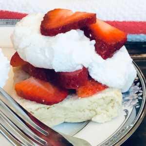 Closeup square photo of gluten free strawberry shortcake.