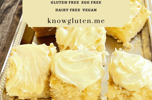 An overhead view of a tray of gluten free lemon cake cut into squares.