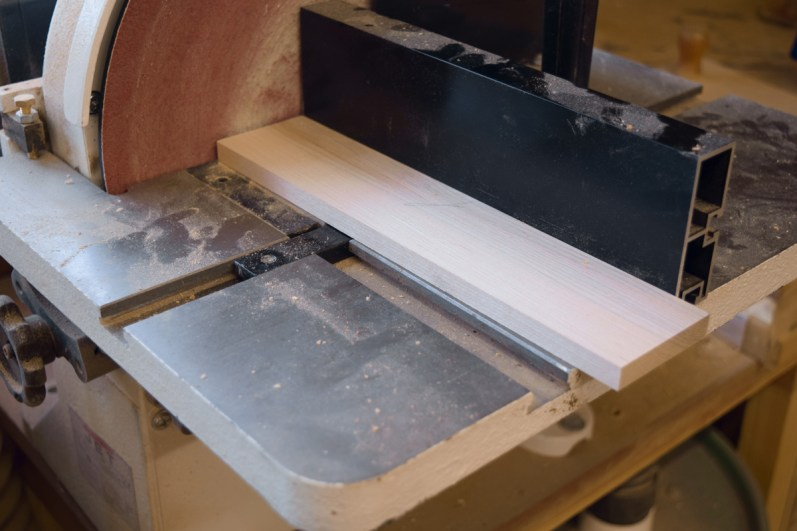 Using disc sander to prepare material