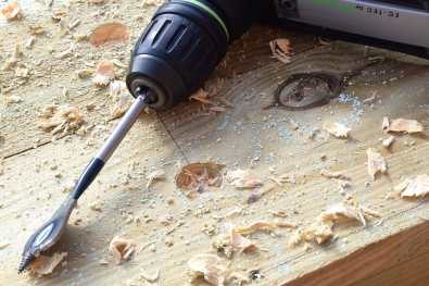 Drill the drainage holes with a 25mm flat bit