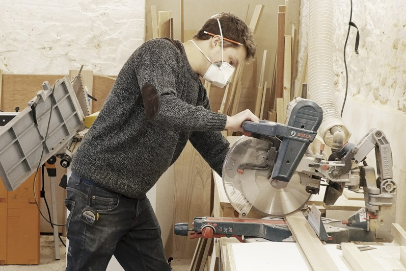 Jamie using circular saw