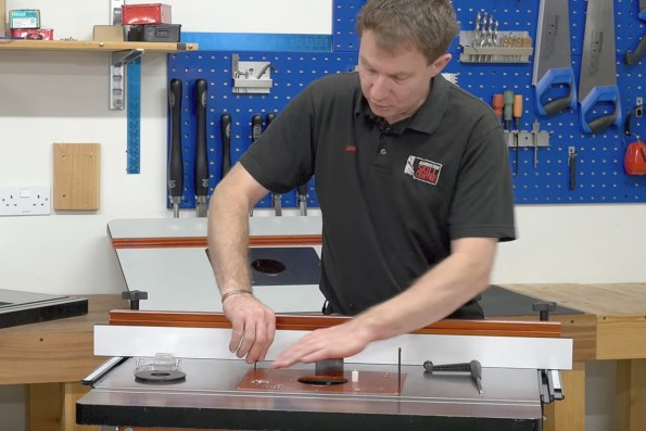 How to set up your router table the knowledge blog tightening the bolts to make the table level keyboard keysfo Choice Image