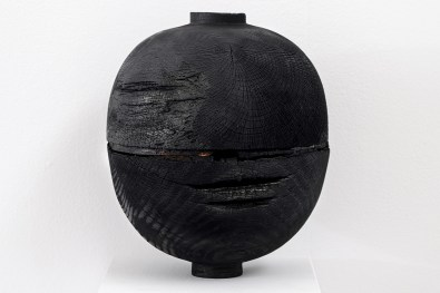black charred wood turned vessel in exhibition