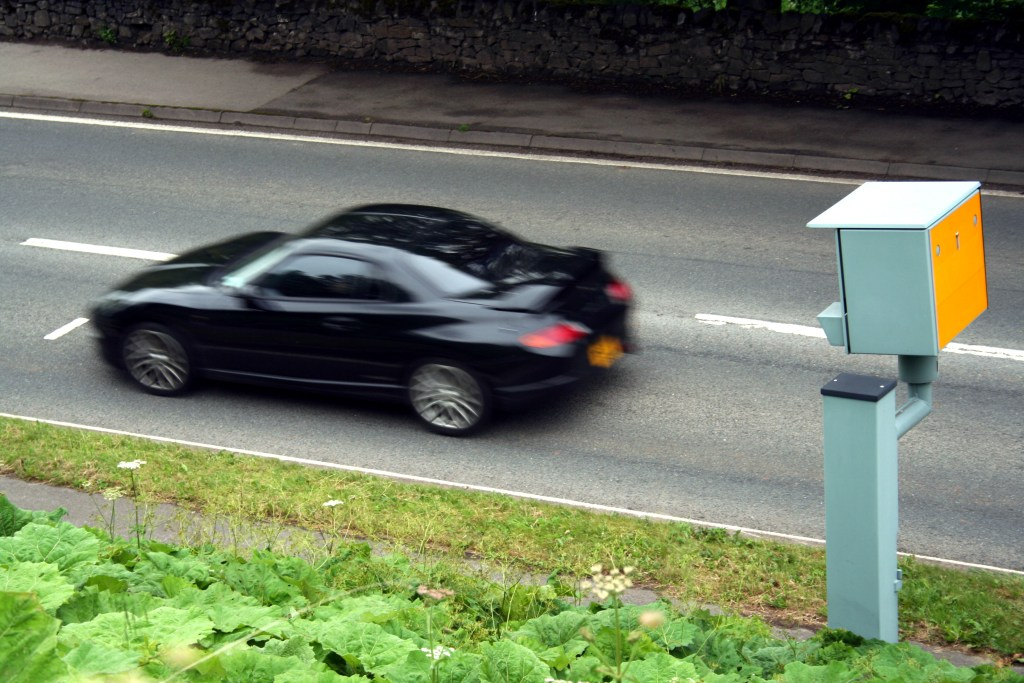 Sports Car Passing a Static Speed Camera