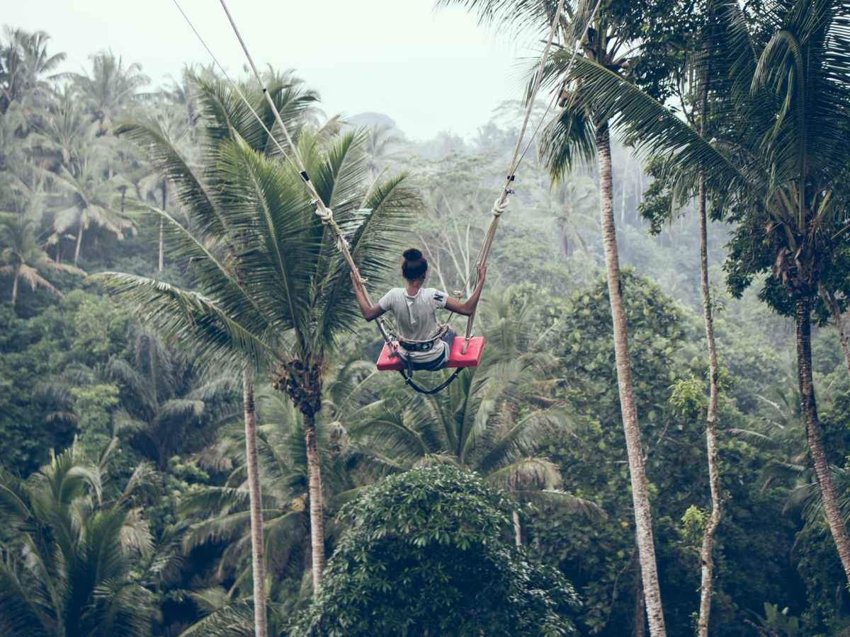 person riding on zip line