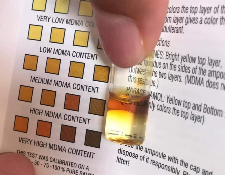 Image of the EZ MDMA Purity test. The reagent has gone pale brown at the top, showing a medium amount of MDMA in the substance tested
