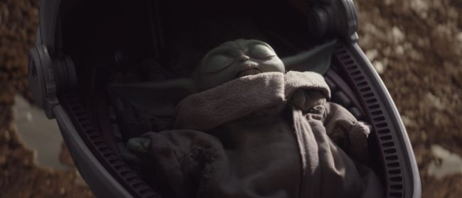 Image, baby Yoda sleeping in his carrier